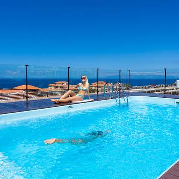 Zwembad dakterras Hotel GF Fanabe