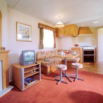 Voorbeeld woonkamer 3-kamerstacaravan Lochy Holiday Park