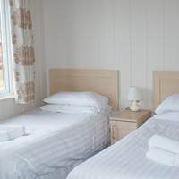 Voorbeeld slaapamer met 2 aparte bedden