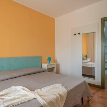 Voorbeeld slaapkamer 2-kamerappartement 4 personen Residence I Mirti Bianchi