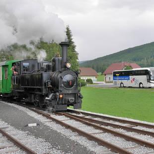 Touringcar met trein