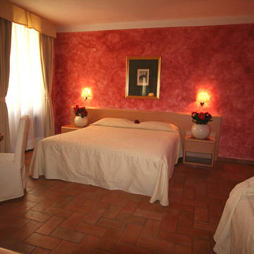 Slaapkamer Hotel Roma