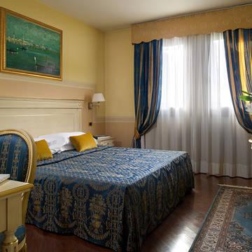 Voorbeeld slaapkamer Villa Pace Park Hotel Bolognese