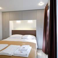 Voorbeeld slaapkamer stacaravan