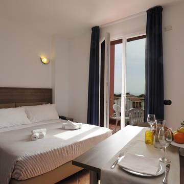 Voorbeeld 1-kamerappartement Appartementen Ai Pozzi Village