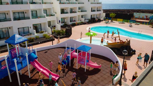 Zwembad en speeltuin Appartementen Galeon Playa