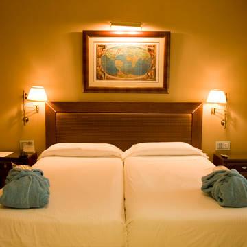 Voorbeeld slaapkamer Gran Hotel Guadalpin Banús