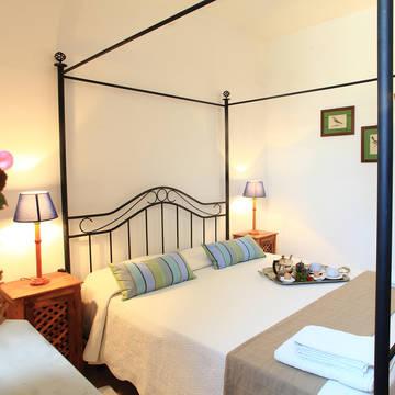 Voorbeeld slaapkamer 3-kamerappartement Fattoria Mongerrate