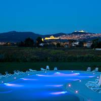 Zwembad hotel met zicht op Assisi