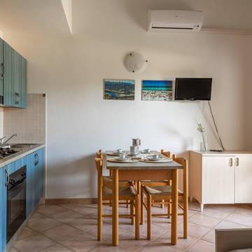 Voorbeeld woonkamer 3-kamerappartement Le Dimore di Budoni