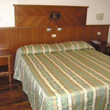 slaapkamer Hotel Le Grotte